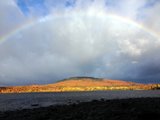 Julie and Patrick capture a rainbow over fall colors on Flagstaff Lake in Maine.